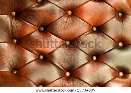 Natural buttoned brown leather texture. Close up. - stock photo