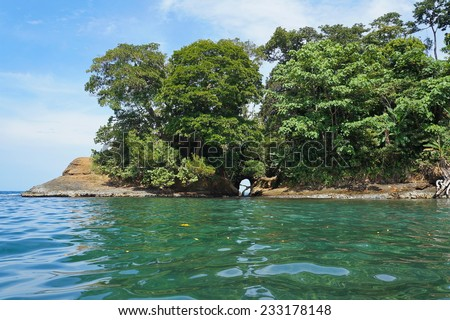 Natural cave in the rock on the Caribbean coast of Costa Rica, Punta uva, Puerto Viejo - stock photo