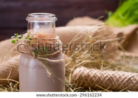 Natural chocolate milkshake is in the hay. - stock photo