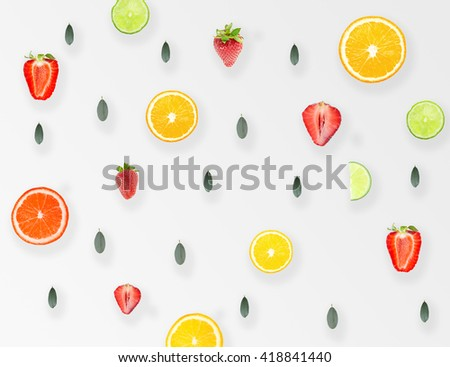 Natural Colorful Pattern Background Made of Citrus Fruits Orange, LIme, Grapefruit, Leaves and Strawberries with Long Shadow. Top View. Flat Design - stock photo