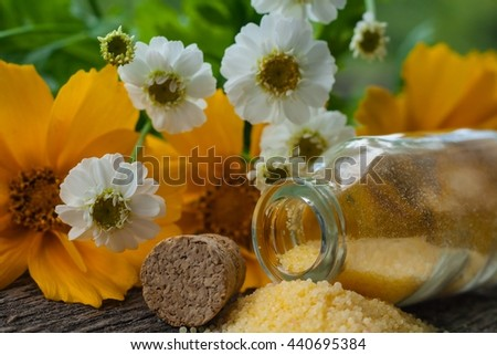 Natural component for rejuvenation of skin . Essential oils in wild flowers . Fragrant salt for bathing . Small small bottles with salt . Relaxation after work of the house . A sauna for health . - stock photo