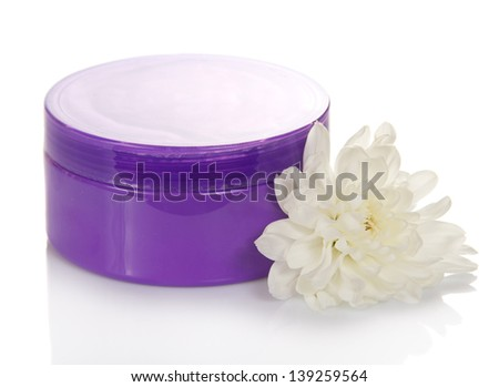 Natural cosmetic cream jar and flower isolated on white