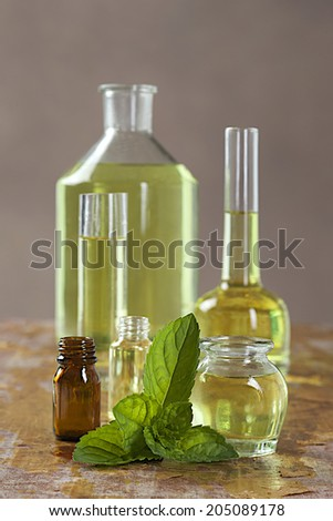 Natural cosmetics - Essence with fresh mint leaves  - stock photo