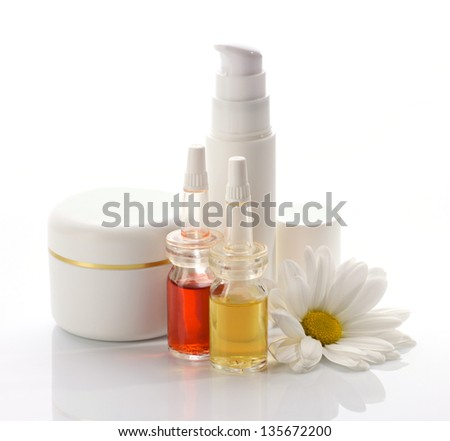 natural cosmetics products and white flower isolated on white