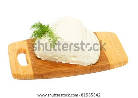 Natural cottage cheese  on wooden board  isolated on white