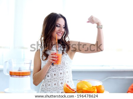 Natural. Cute, curly woman with orange juice - stock photo