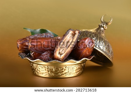 Natural date fruits, gold plate. - stock photo