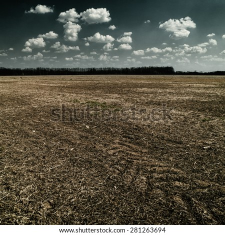 natural disaster. abstract landscape with dry land under mood skies - stock photo