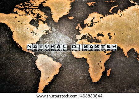 NATURAL DISASTER on white cube - stock photo