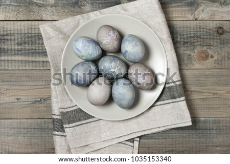 Natural Dyed Gray Easter Eggs In Plate With Napkin On Rustic Grey Wooden  Background. Top