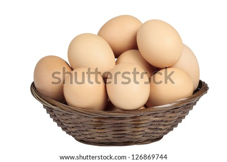 Natural eggs in a basket isolated on white