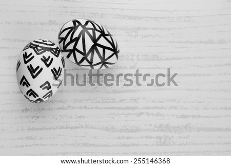 Natural eggs with free hand sketch patterns set on a tile background for Easter. Black and white image. - stock photo