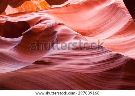 Natural erosion creates a background of colorful layered angular rock in Canyon X located in Page, AZ. - stock photo