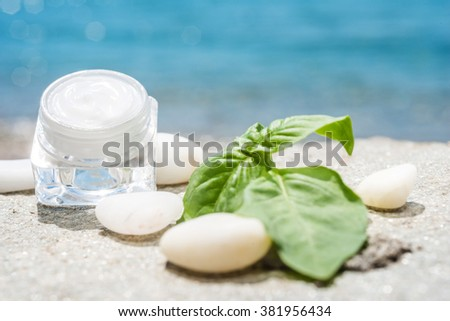 Natural facial cream with mint and sea as background