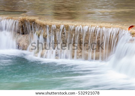 Natural flowing texture of waterfall cascades in Thailand, Erawan National Park.