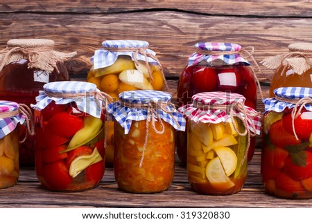 Natural food. Close-up of glass jars with preservation.  - stock photo