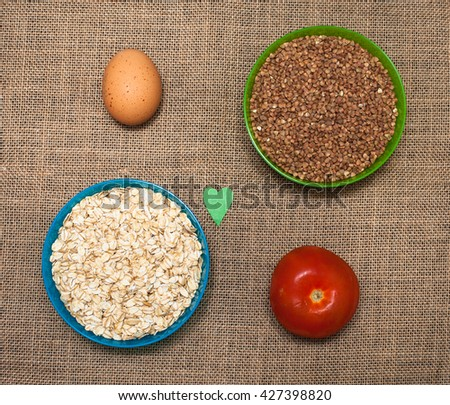 Natural food. Rice, vegetables and egg on the table - stock photo