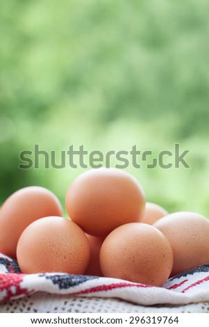 Natural free range chicken eggs. Shallow depth of field. - stock photo