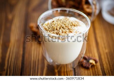 Natural fresh yogurt with nuts - stock photo