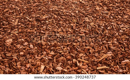 Natural full frame background on angled view of red and brown pieces of tree bark wood chip mulch for gardening or natural themes