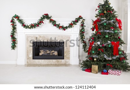 Natural Gas Fireplace with fully decorated Christmas tree in living room of home during holidays - stock photo