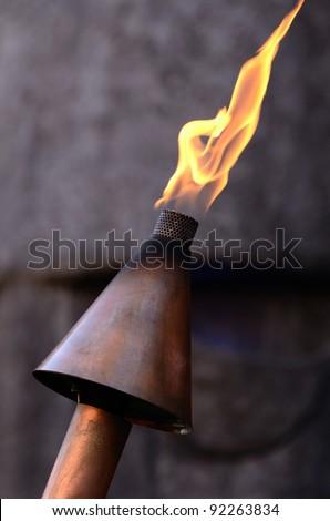 Natural gas tiki torch at a downtown bar - stock photo