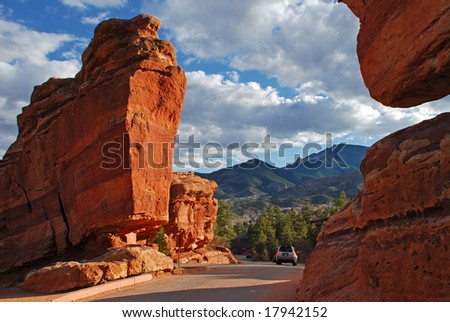 Natural Giant red rock formations at the Garden of the Gods Park near Colorado Springs, Colorado which serves as a drive through entrance - stock photo
