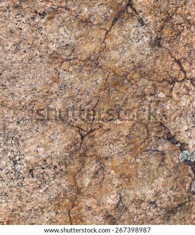 Natural granite stone texture background. Rough and rusty. Close-up, macro