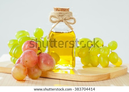 Natural grapeseed oil for massage, skincare and haicare - stock photo