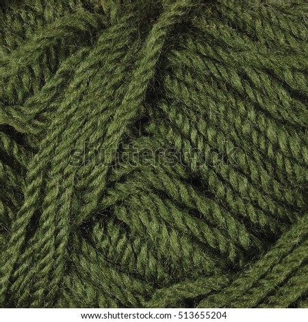 Natural green fine wool threads texture, textured clew macro closeup background pattern