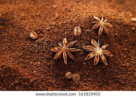 Natural ground coffee background with star anise, coffee beans and some spilled sugar