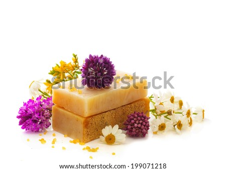 Natural handmade herbal soap with wild flowers isolated over white - stock photo