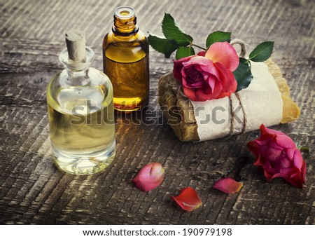 Natural handmade soap and aroma oil on wooden background. Selective focus, horizontal. Rustic style. - stock photo