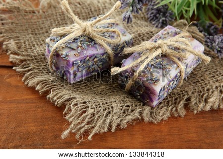 Natural handmade soap, on wooden background - stock photo