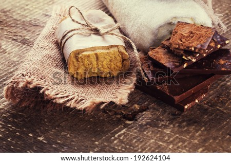 Natural handmade soap on wooden background. Spa setting. Selective focus. Rustic style. Toned image. - stock photo