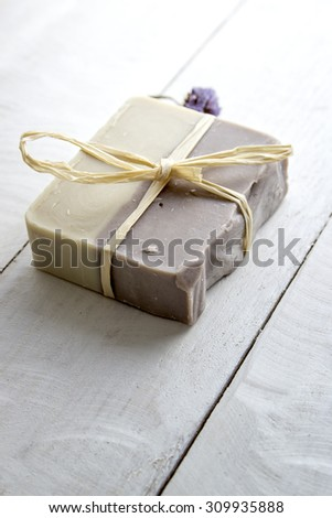 Natural handmade soap over wooden background - stock photo