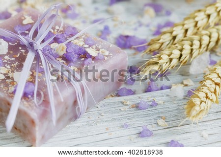 Natural handmade soap, sea salt, towel, oat flakes and wheat ears on a white wooden background.  - stock photo