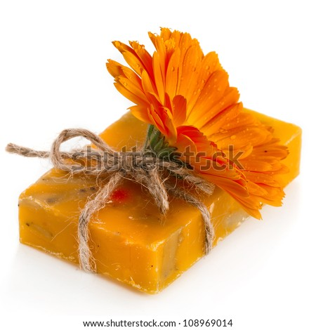 Natural handmade soap with marigold (Calendula officinalis)  , isolated on white - stock photo