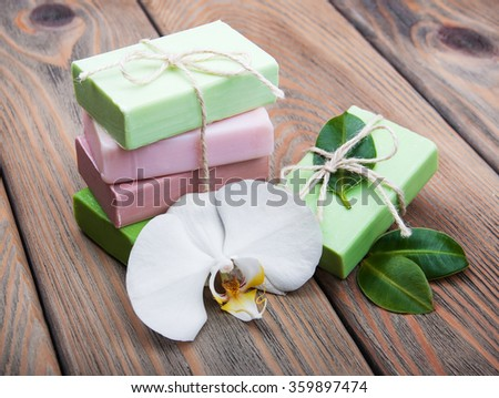Natural handmade soap with orchid on a old wooden background