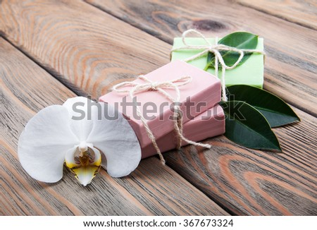 Natural handmade soap with orchid on a old wooden background - stock photo