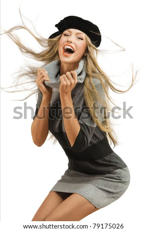 Natural happiness. A portrait of a laughing young woman in knitted dress wearing beret. - stock photo