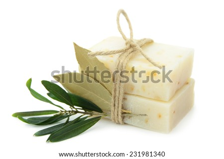 Natural herbal soaps with olive and bay leaf isolated on white background.  - stock photo