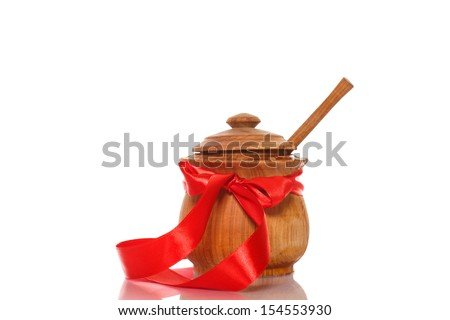 natural honey in a wooden pot on white background - stock photo