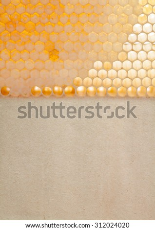 Natural honeycomb pattern. Organic yellow, gold honeycomb texture with fresh honey. closeup of honey combs. Shallow field of deep, soft focus. Vintage paper background, copy space. - stock photo