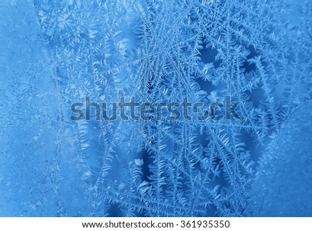 Natural ice pattern on window winter glass - stock photo