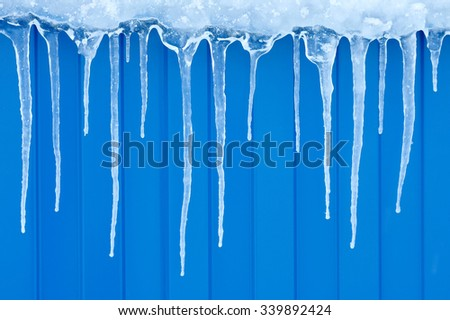 Natural icicles hanging on a blue background.