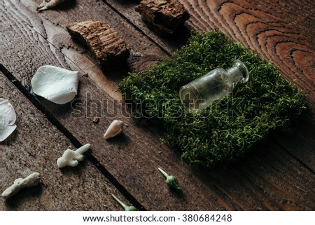 Natural ingredients for perfume on old wooden desk