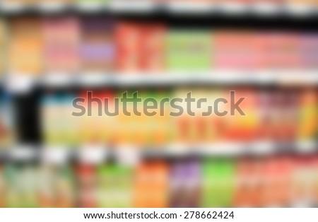 natural juice bottles beverage product on supermarket shelves - stock photo