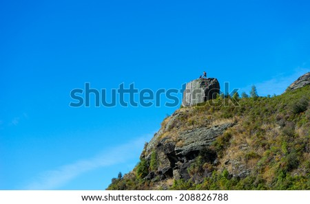 Natural landscape of New Zealand alps and hikers