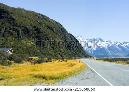 Natural landscape of New Zealand alps and road - stock photo